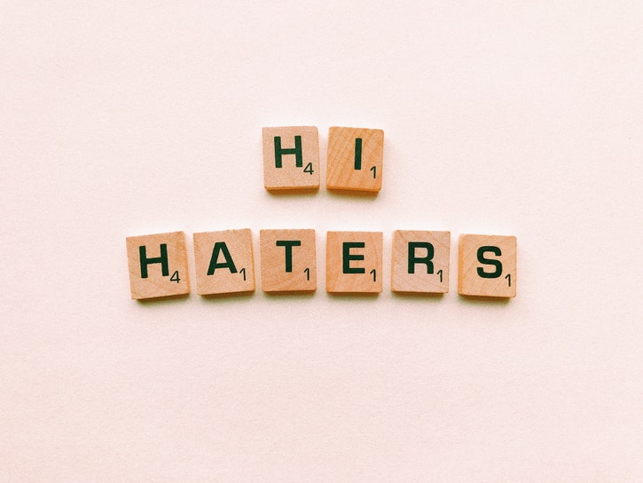 """Scrabble letters arranged to spell """"Hi Haters""""."""